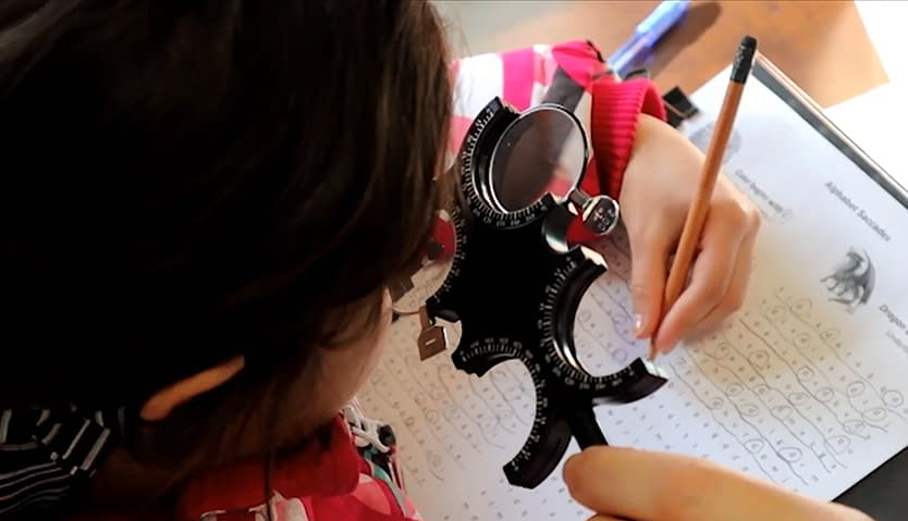 A young girl doing a vision skills exercise