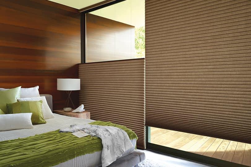 Hunter Douglas Alustra® Duette® Honeycomb Shades installed in a bedroom