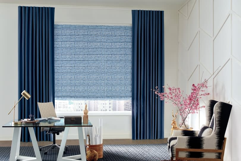 Navy colour curtains in an office